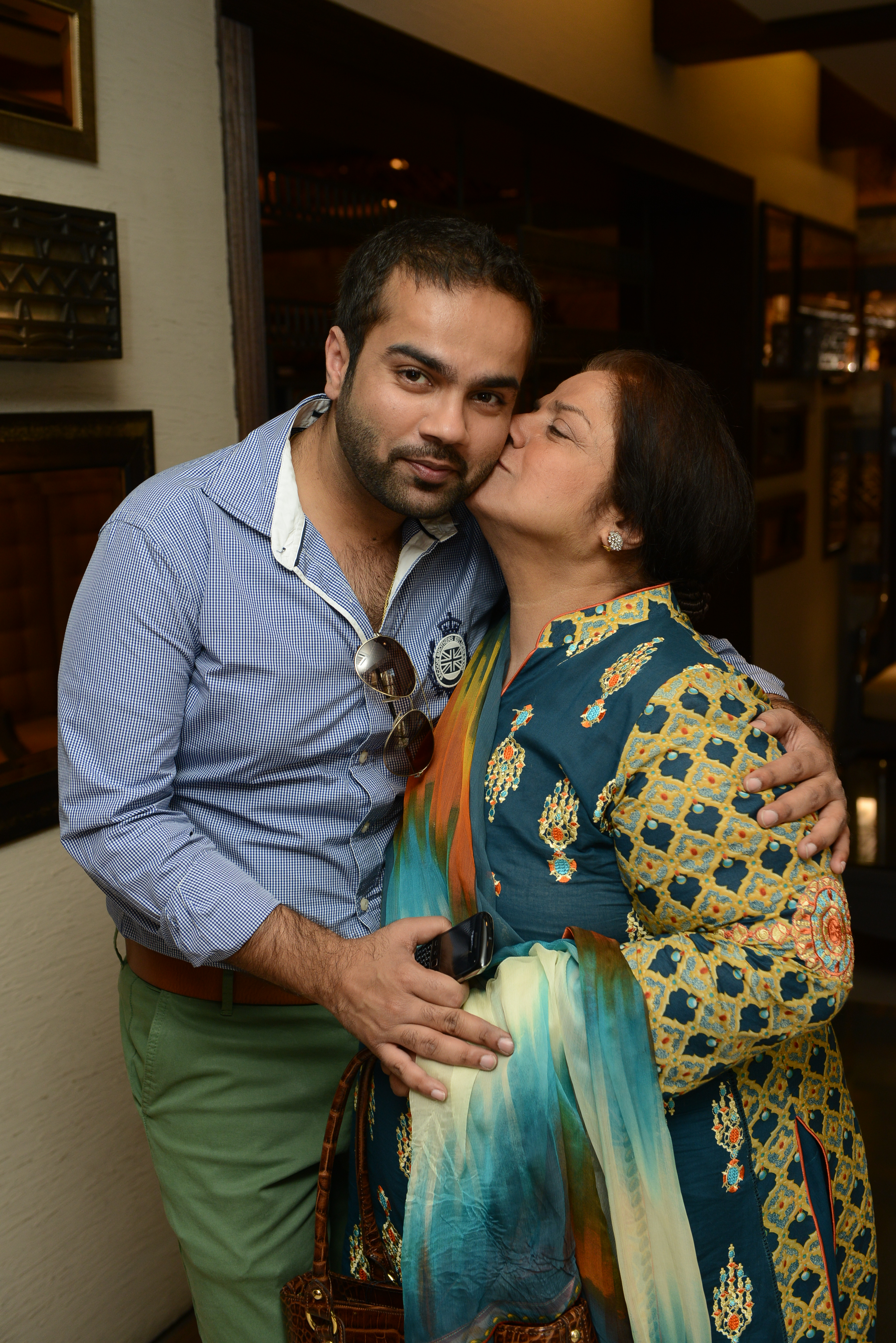 Faraz gets a kiss from his proud mother, Memoona Manan