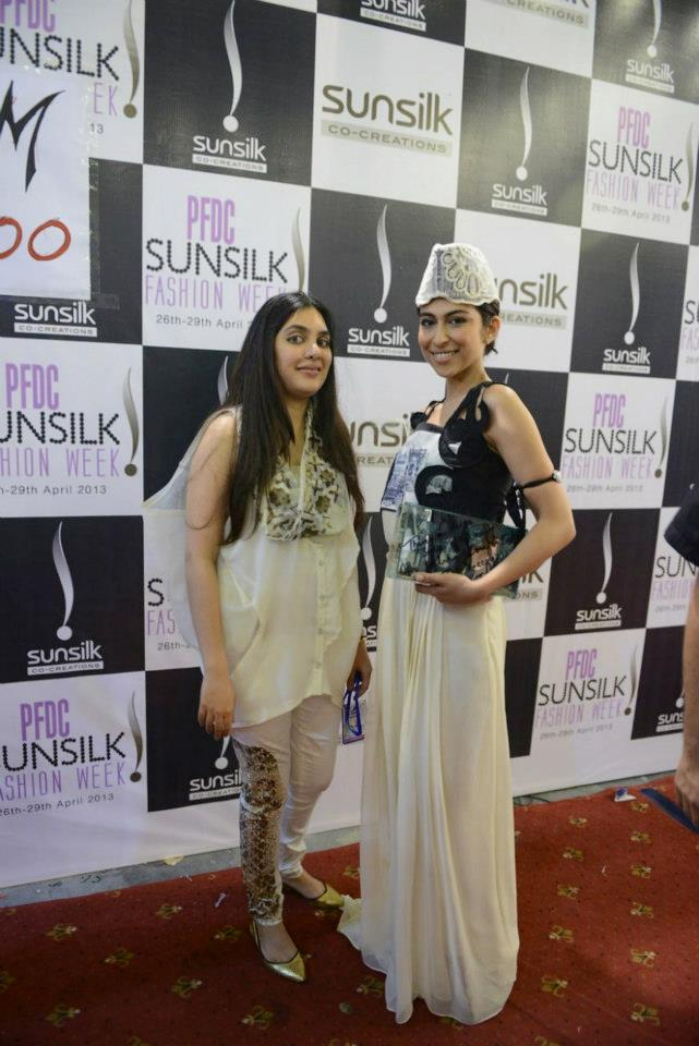 Mahgul Rashid ( adorned white jeans with old photos) with Meesha Shafi
