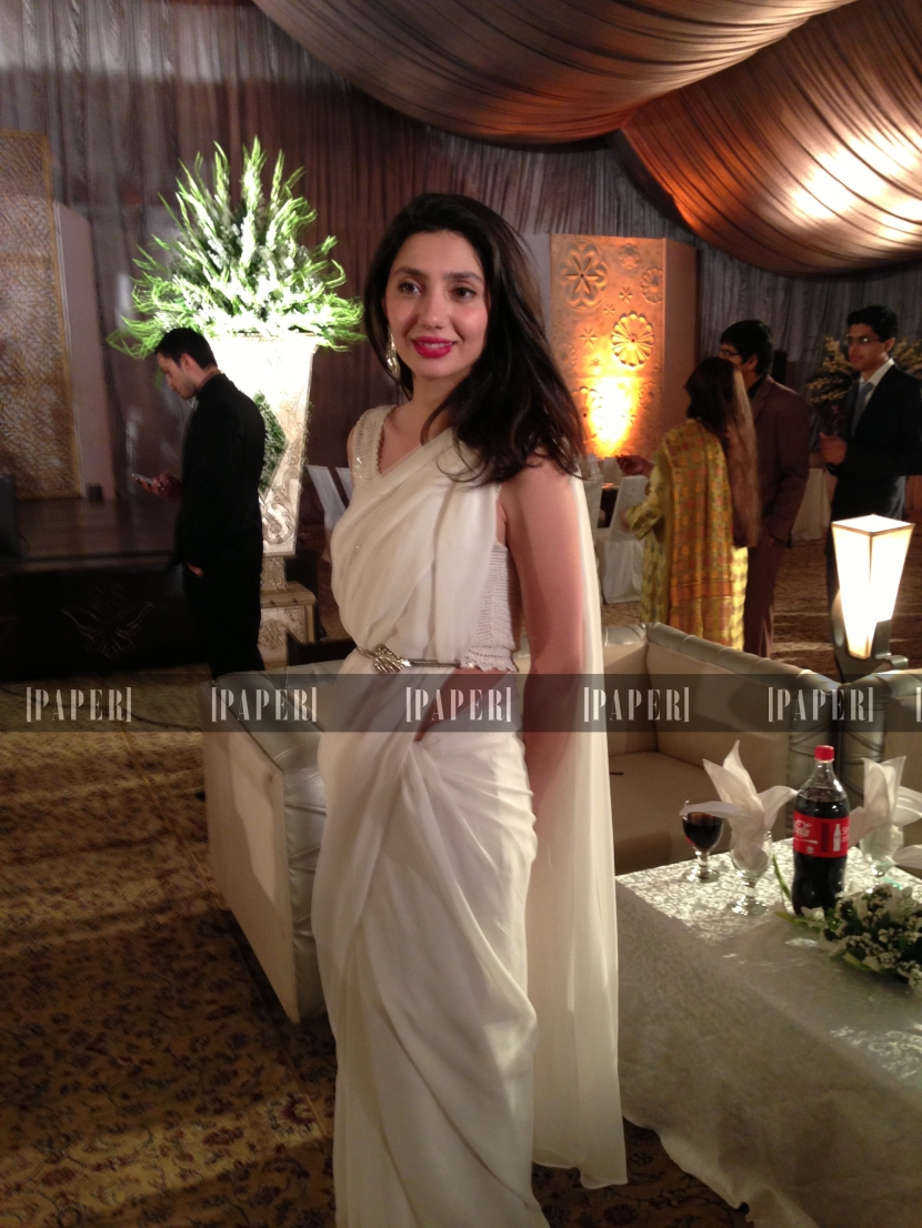 Mahirah Khan gorgeous in a white sari and red pout